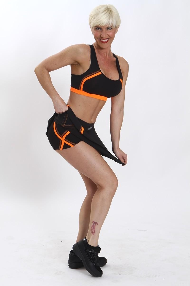 precio bajo gran colección vista previa de Tops Fitness Mujer Negro/Naranja